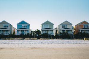 row of homes on beach